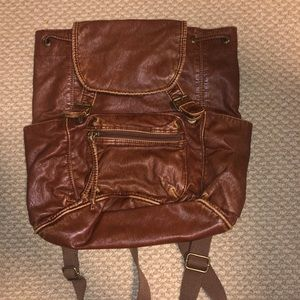 Brown worn looking backpack
